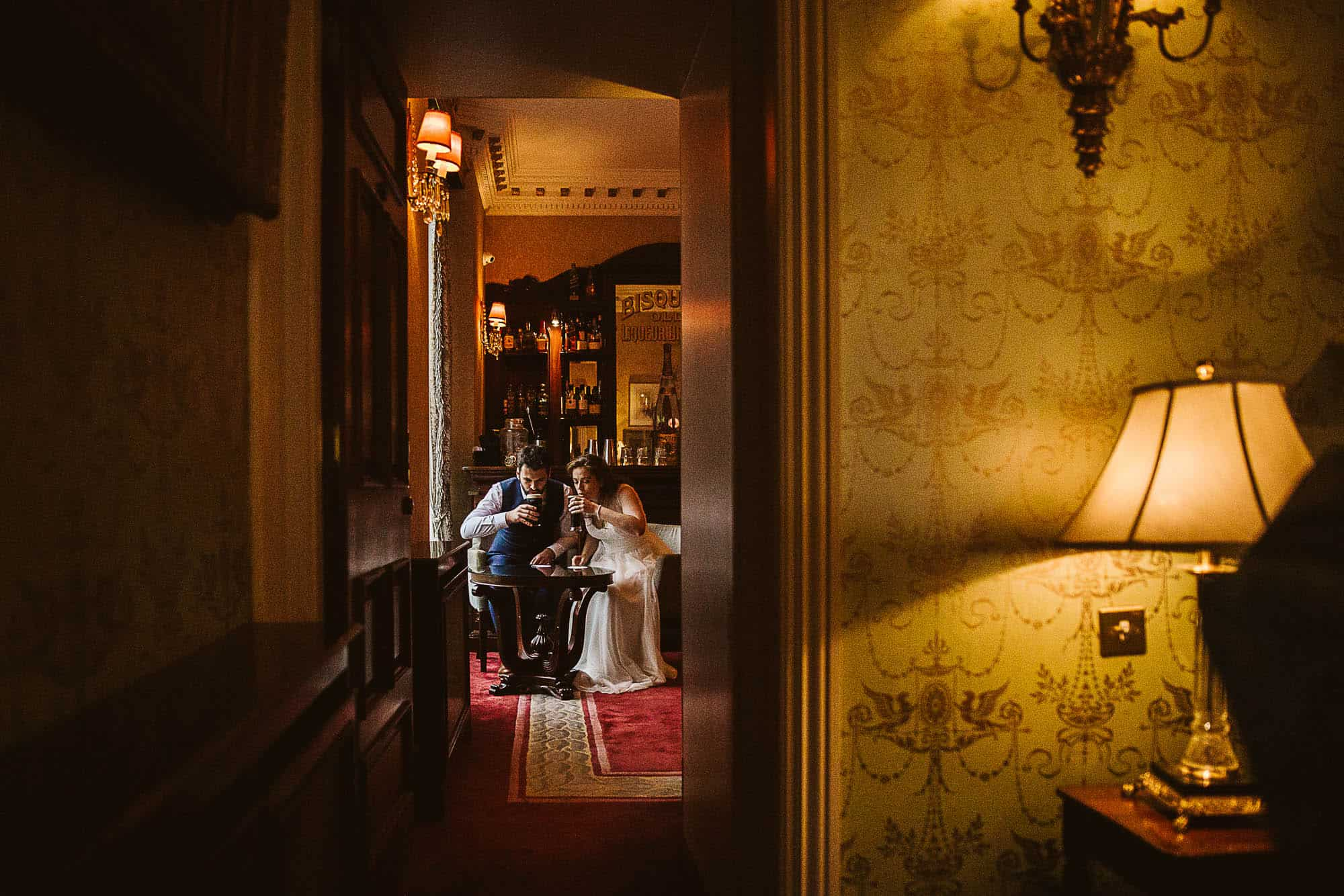A Couple having a drink in the bar on their Irish castle elopement