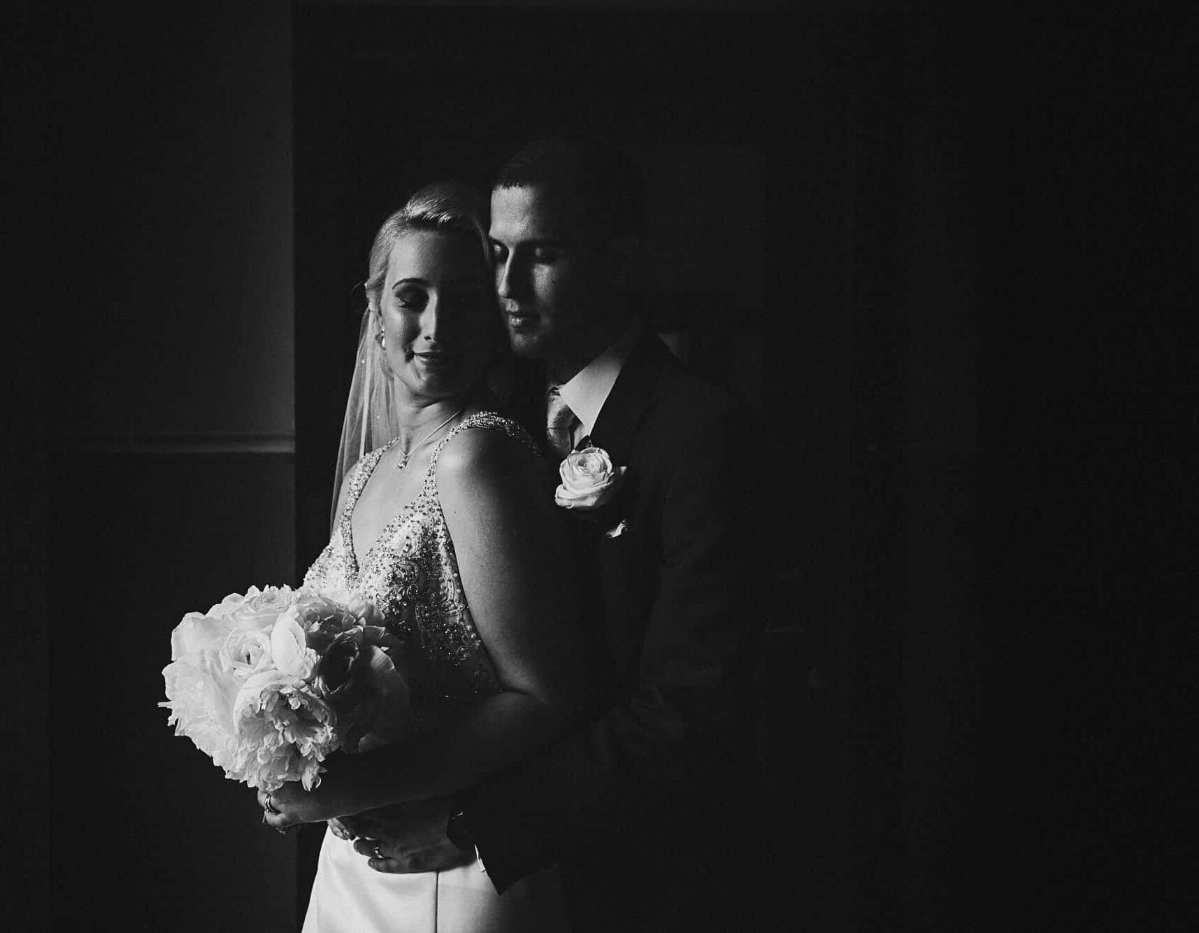 elopement-planner-galway-intimate window, A couple hold each other in window light as they elope to Ireland